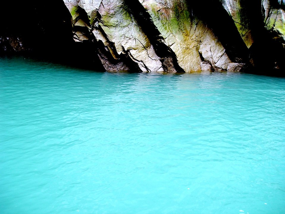 Glacial outflow with characteristic aquamarine color where glacial meltwater merges with the salt water of the fjord.