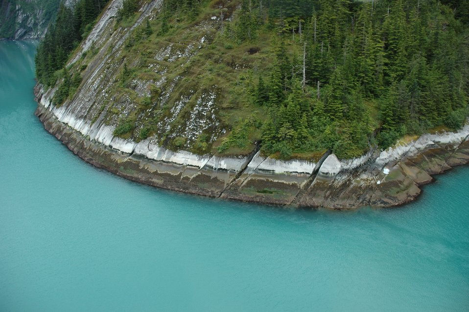 Aerial photograph. Multi-colored shoreline in Tracy Arm showing erosion pattern following the joint pattern in the rocks.