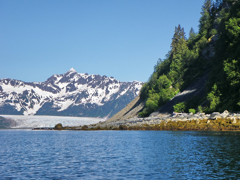 Rocky shoreline, a glacier coming to the sea, and high mountain peaks.  Hogg Bay has it all.