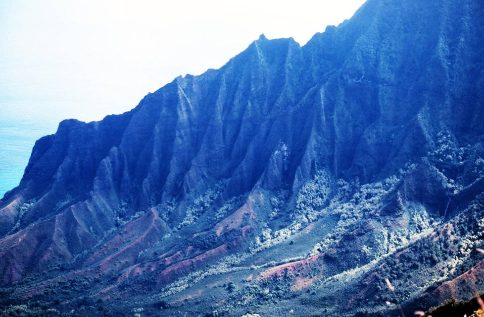 A knife-edge ridge on Kauai on the Na Pali coast.  The ridge looms over the Kalalau Valley.