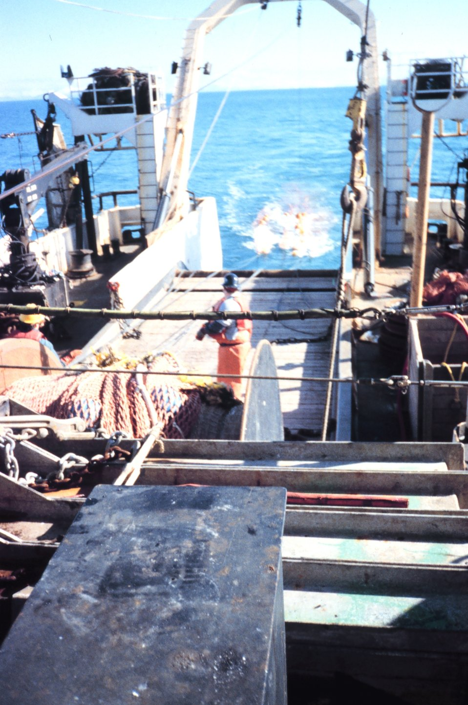 Photo # 3 - Streaming net during  trawling operations.  Yellow floats are pulled underwater but help keep the mouth of the net open while being towed.