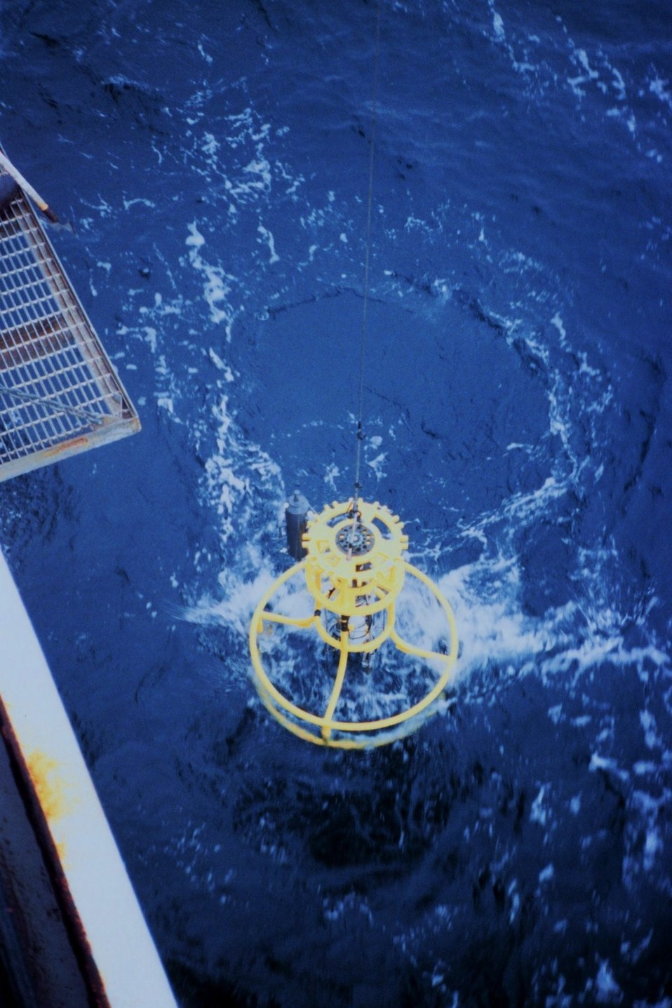 Conductivity-Temperature-Depth measuring instrument being let down to the water surface.