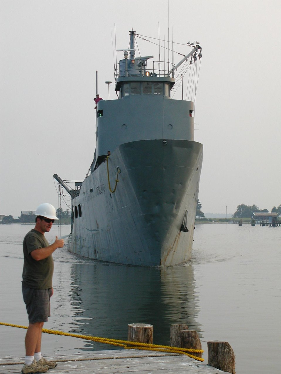 NMFS port agent waiting to inspect menhaden boat as it arrives in port.