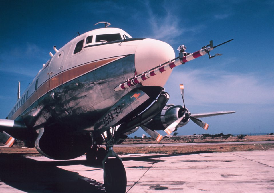 Weather Bureau DC-6 N6539C on tarmac with ESSA designator.  Gust probe in foreground