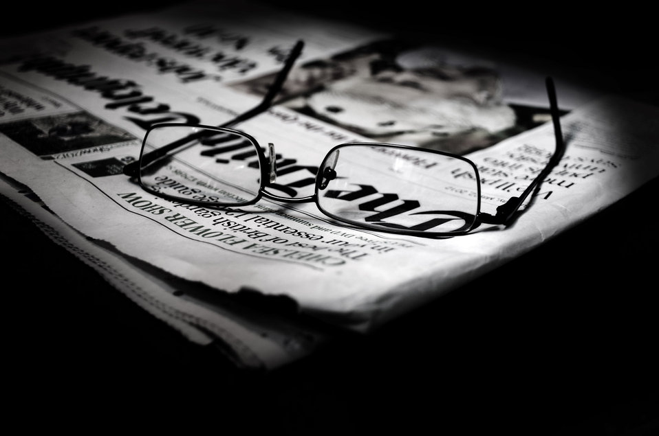 Newspapers and glasses