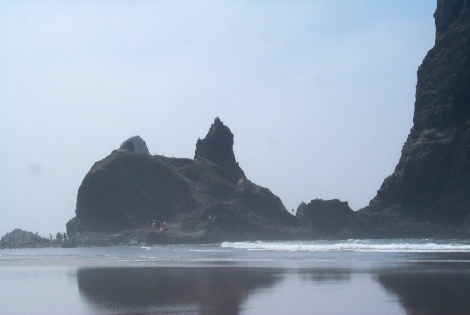 Looking south at the base of Haystack Rock at Cannon Beach.