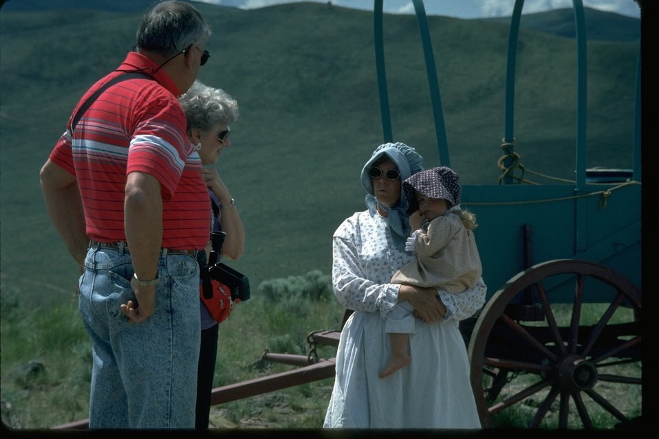 Visitors of the NHOTIC are speaking with pioneer woman.