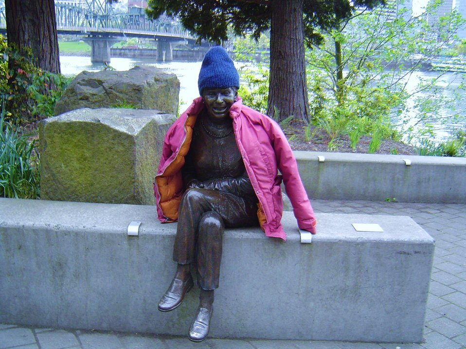 Even statues get cold.  Friendly statue relaxing along the Willamette River.