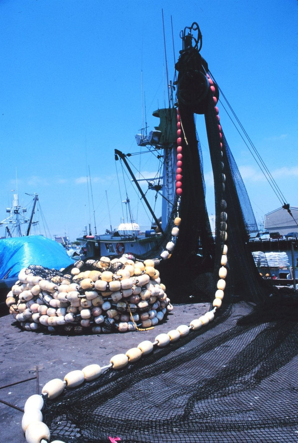 The paraphernalia of fishing on the pier - mountains of nets, floats, etc.