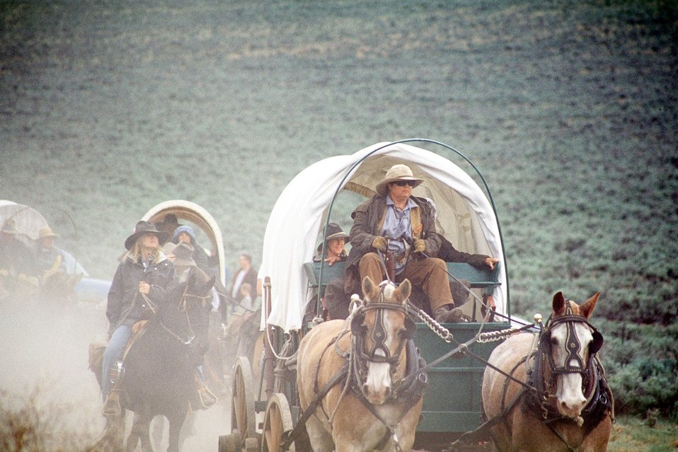 NHOTIC 10th Anniversary, wagon train reenactment. Pioneers and covered wagons on the Oregon Trail.