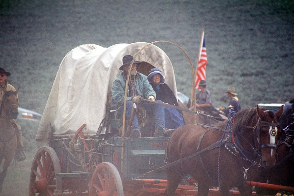 NHOTIC 10th Anniversary, wagon train reenactment. Pioneers and covered wagon on the Oregon Trail.