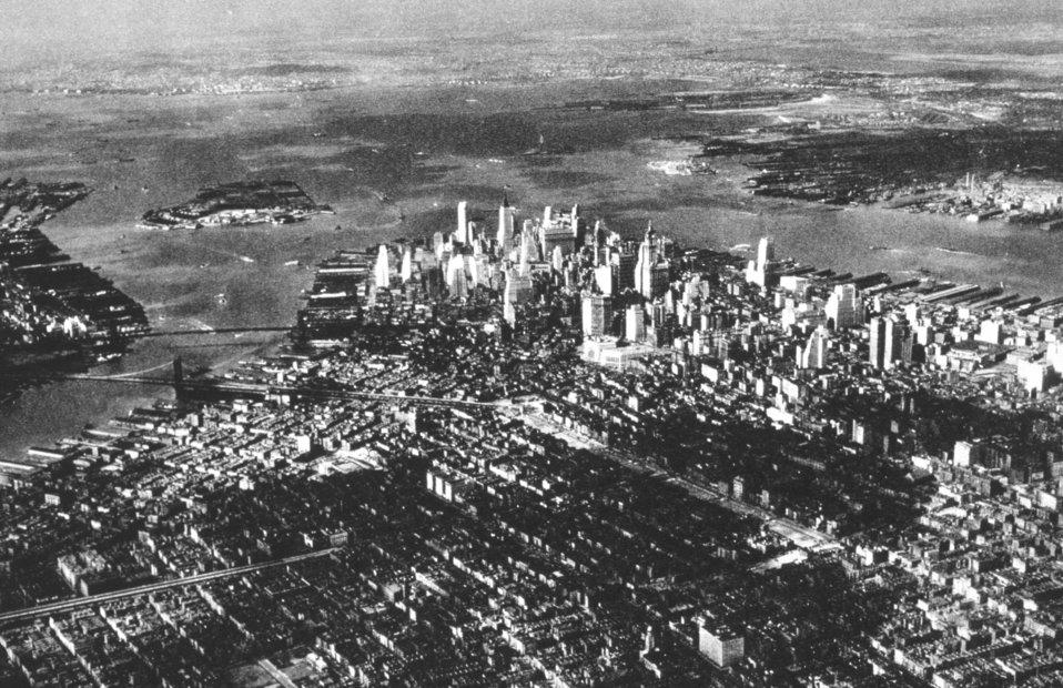 Downtown New York in the early morning sun.  In: 'Flug Und Wolken', Manfred Curry, Verlag F. Bruckmann, Munchen, 1932.