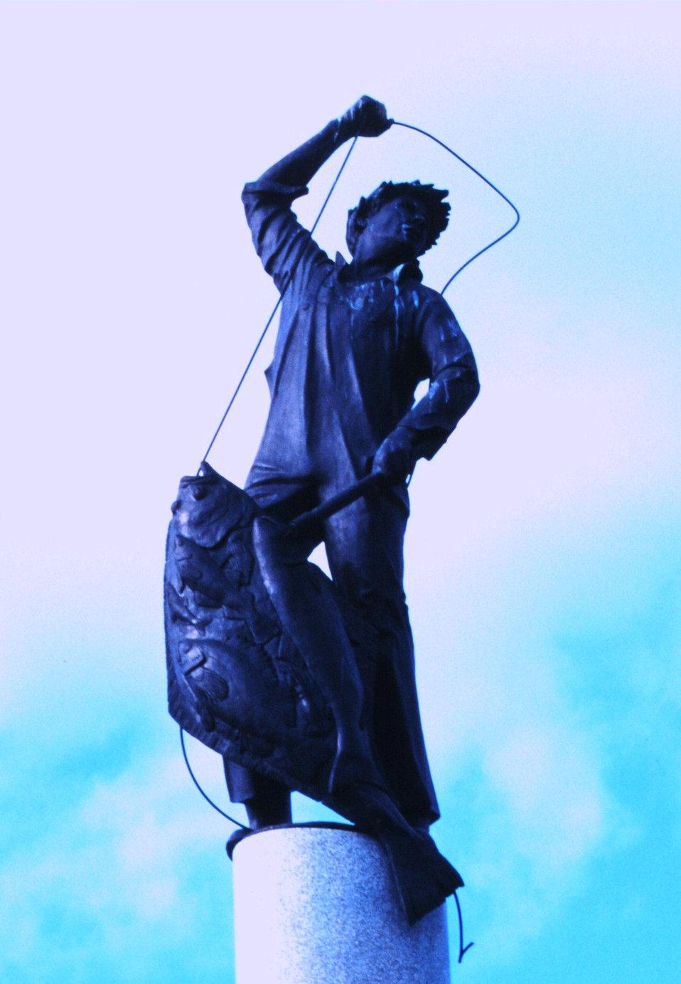 Statue of halibut fisherman adorning top of Seattle's Fishermen's Memorial