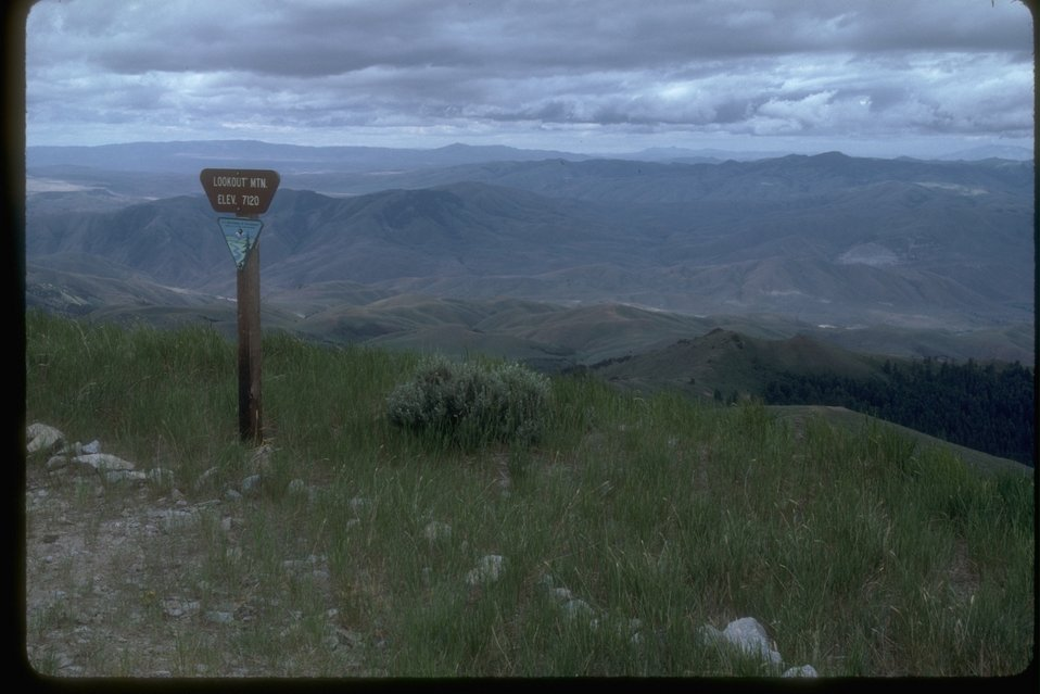 """View from Lookout Mountain.  Sign Reads: """"Lookout Mountain, Elevation 7120'."""