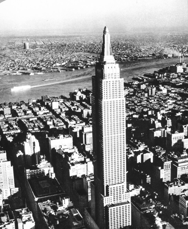 The Empire State Building in the late afternoon sun.  In: 'Flug Und Wolken', Manfred Curry, Verlag F. Bruckmann, Munchen, 1932.
