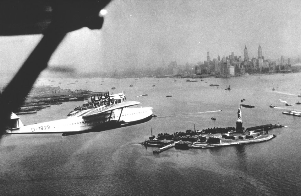 A flying boat on arrival at New York passing over the Statue of Liberty.  In: 'Flug Und Wolken', Manfred Curry, Verlag F. Bruckmann, Munchen, 1932.