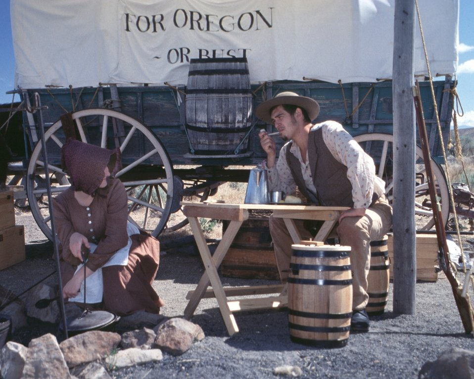 Rebecca Crow and Brandon Kames portray a pioneer couple at a wagon encampment.