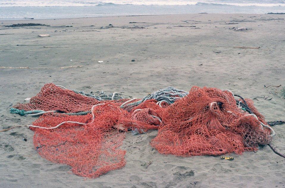 Point Reyes Great Beach.  Marine debris ghost net washed up on beach.