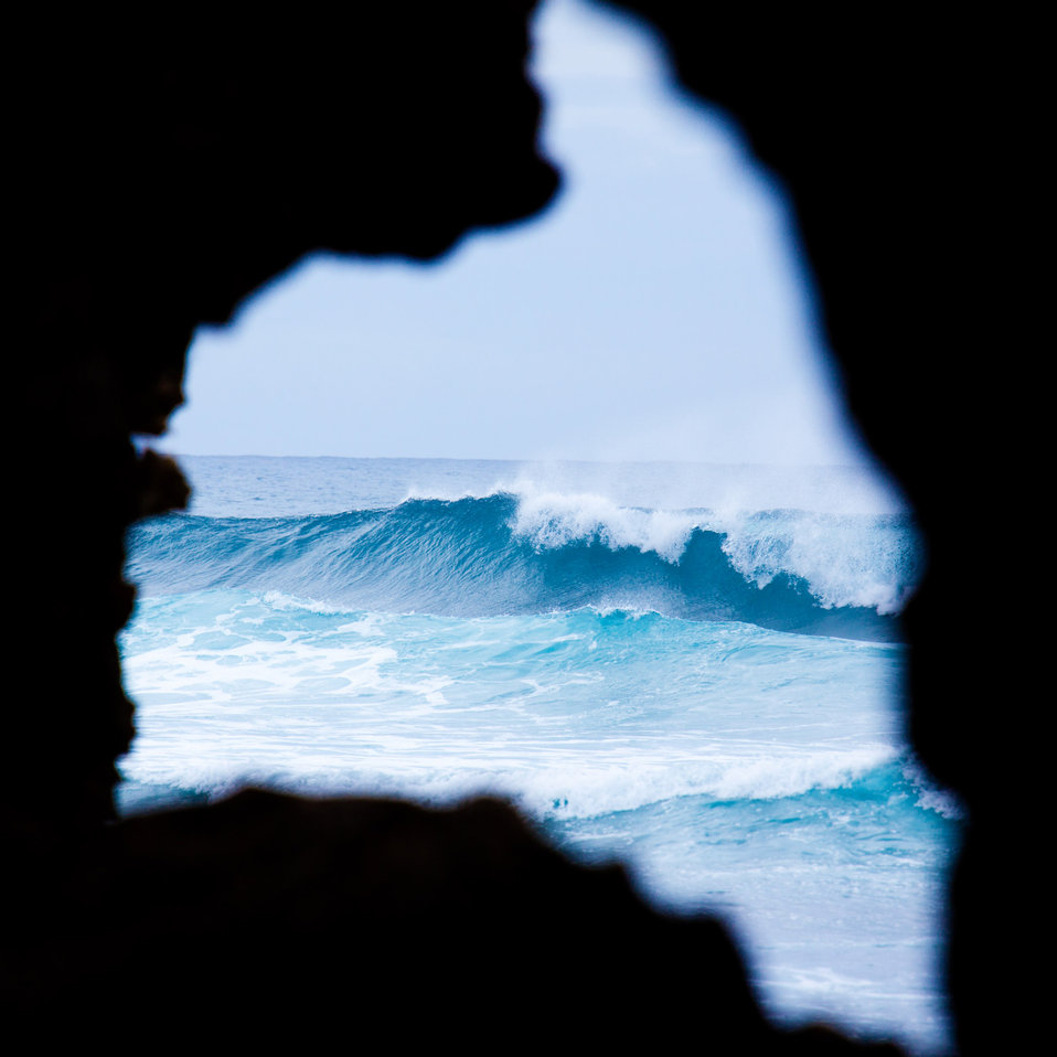 Waves through rock window