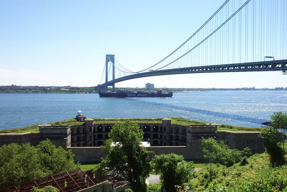The 950-foot containership SEALAND COMMITMENT passing underneath the Verrazano Narrows Bridge.