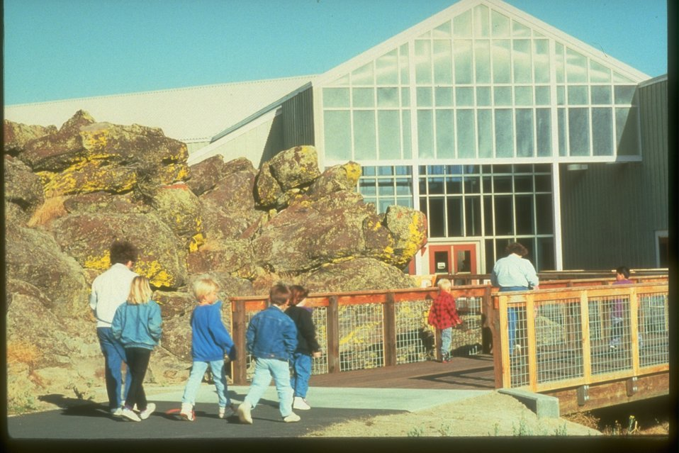 Visitors walking into the entrance of the Interpretive Center building.