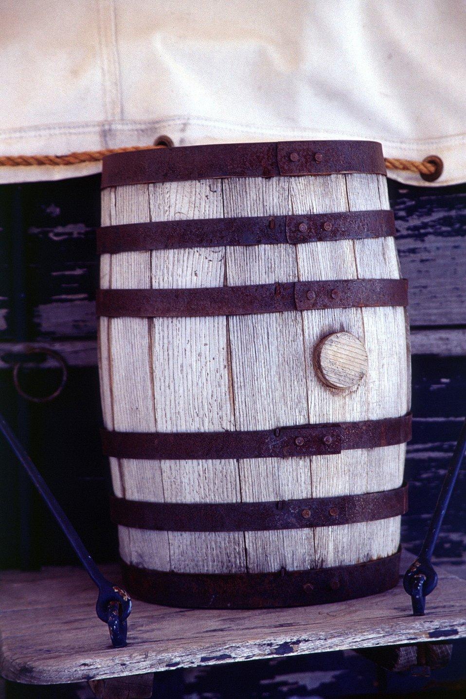 Medium shot of water barrel on covered wagon. NHOTIC 10th Anniversary.