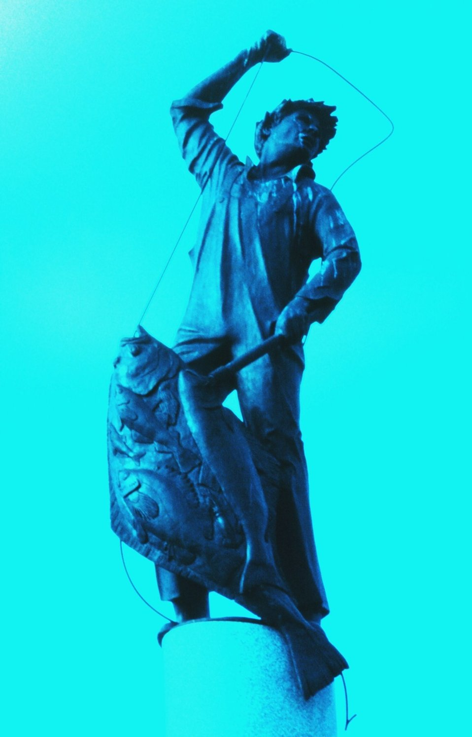 Statue of halibut fisherman adorning top of Seattle's Fishermen's Memorial