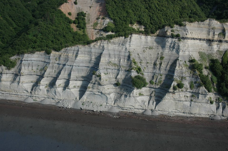 Aerial photograph. Stratified sedimentary layers in Kachemak Bay.