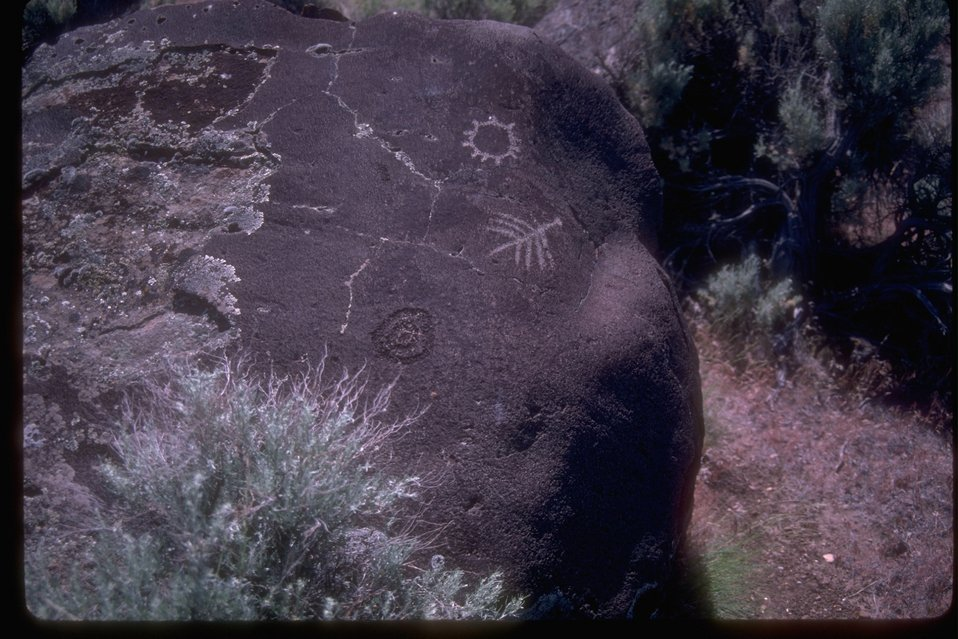 Pictograph located on large rock in sagebrush area.