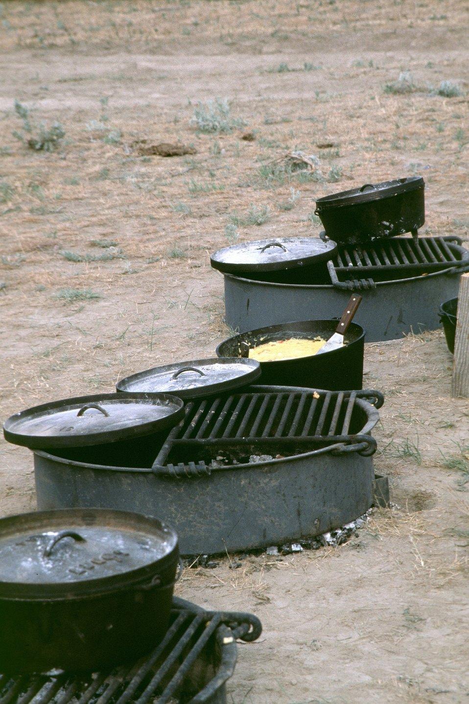NHOTIC 10th Anniversary, wagon train reenactment. Pots, pans, and campfire at encampment.