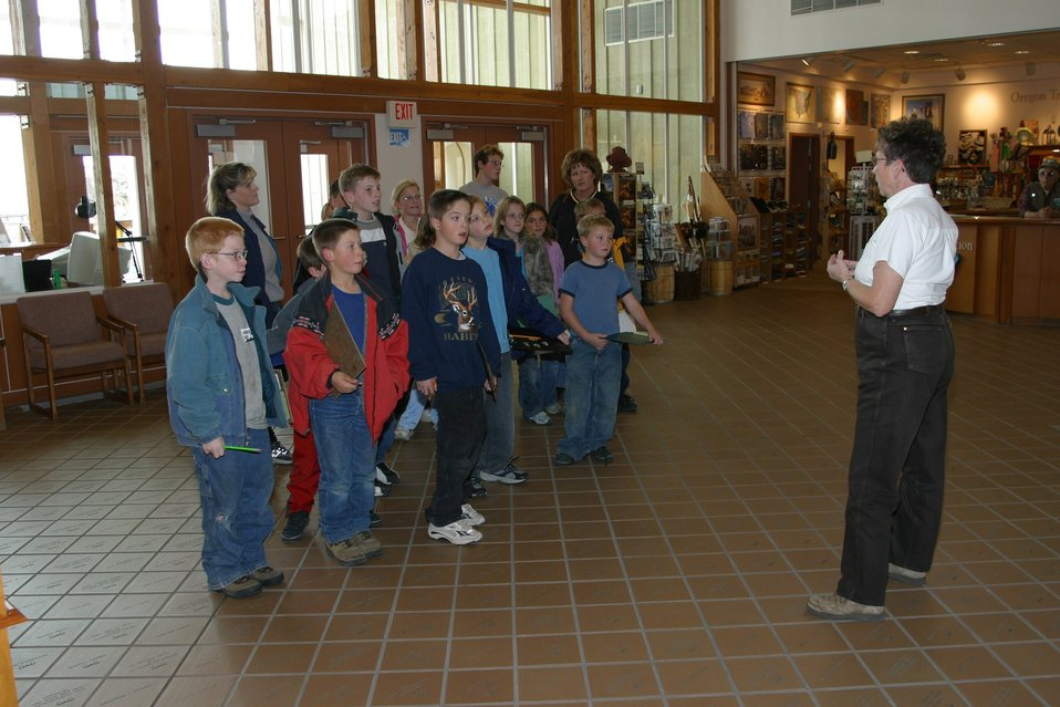 BLM employee Virginia Bloom giving students instructions for their self guided tour of the Nional Historic Oregon Trail Center.