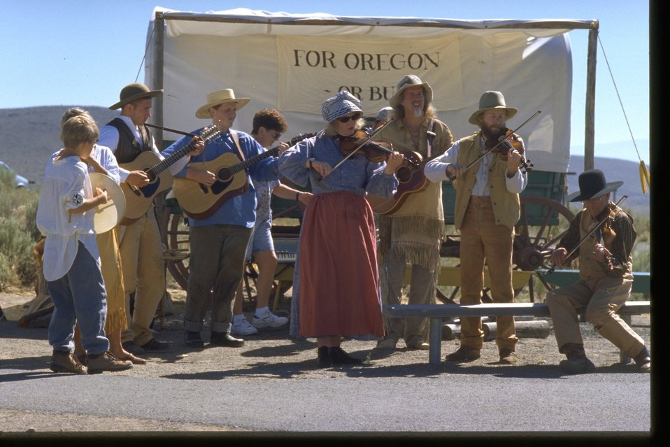 Musicians at the Pioneer Festival outside of the NHOTIC.