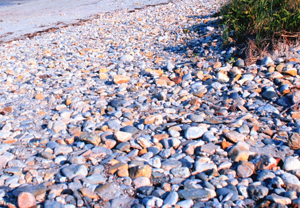 A pebbles on the beach near the port of Galilee