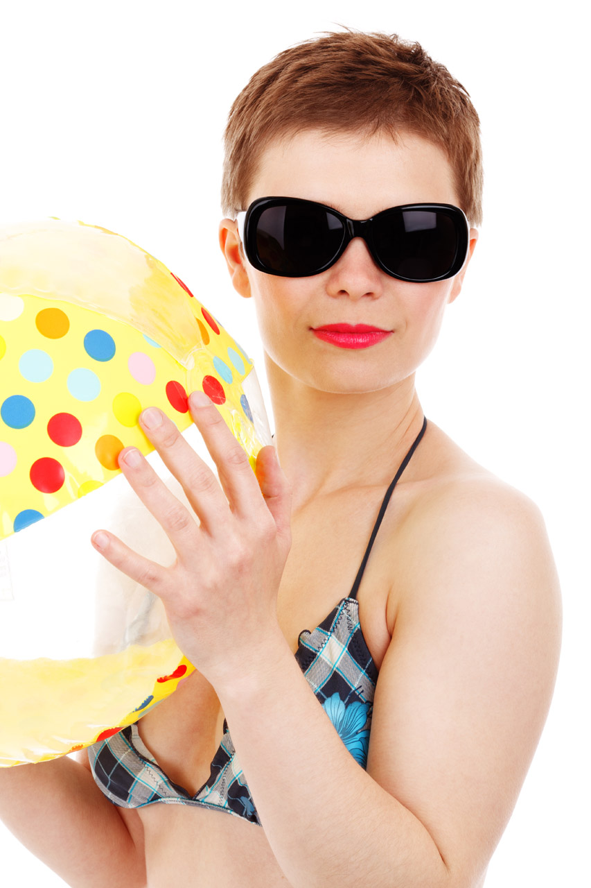 Woman and beach ball