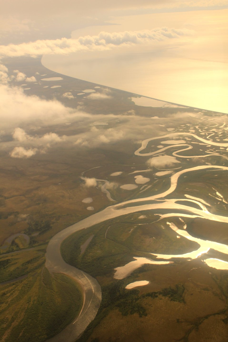 Flying over the Unalakleet River Delta in the late afternoon on the way to Anchorage. Norton Sound in upper right.