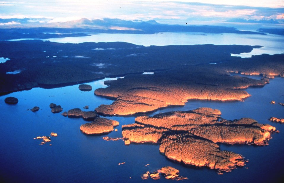 Late afternoon sun illuminates islands and mountains of Prince William Sound area