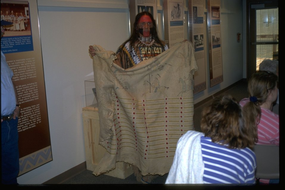 Michael Terry displaying Native American artifacts for visitors at the NHOTIC.