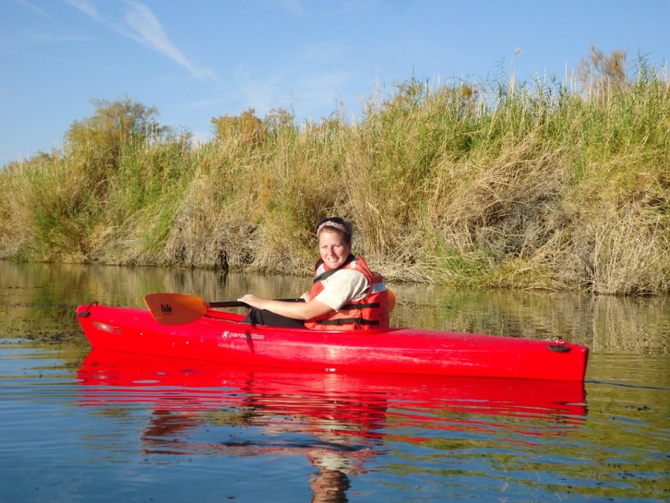 Kelly Lockman wildlife monitoring in kayak