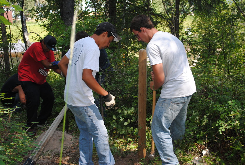 Montana Tribal Conservation Corps Youth Bulding New a Fence at Creston's Nature Trail