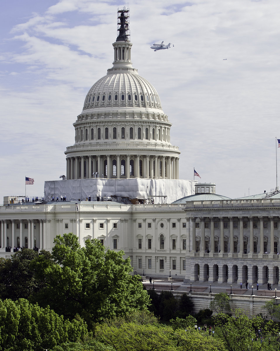 Shuttle Discovery flying past the U.S. Capitol Dome