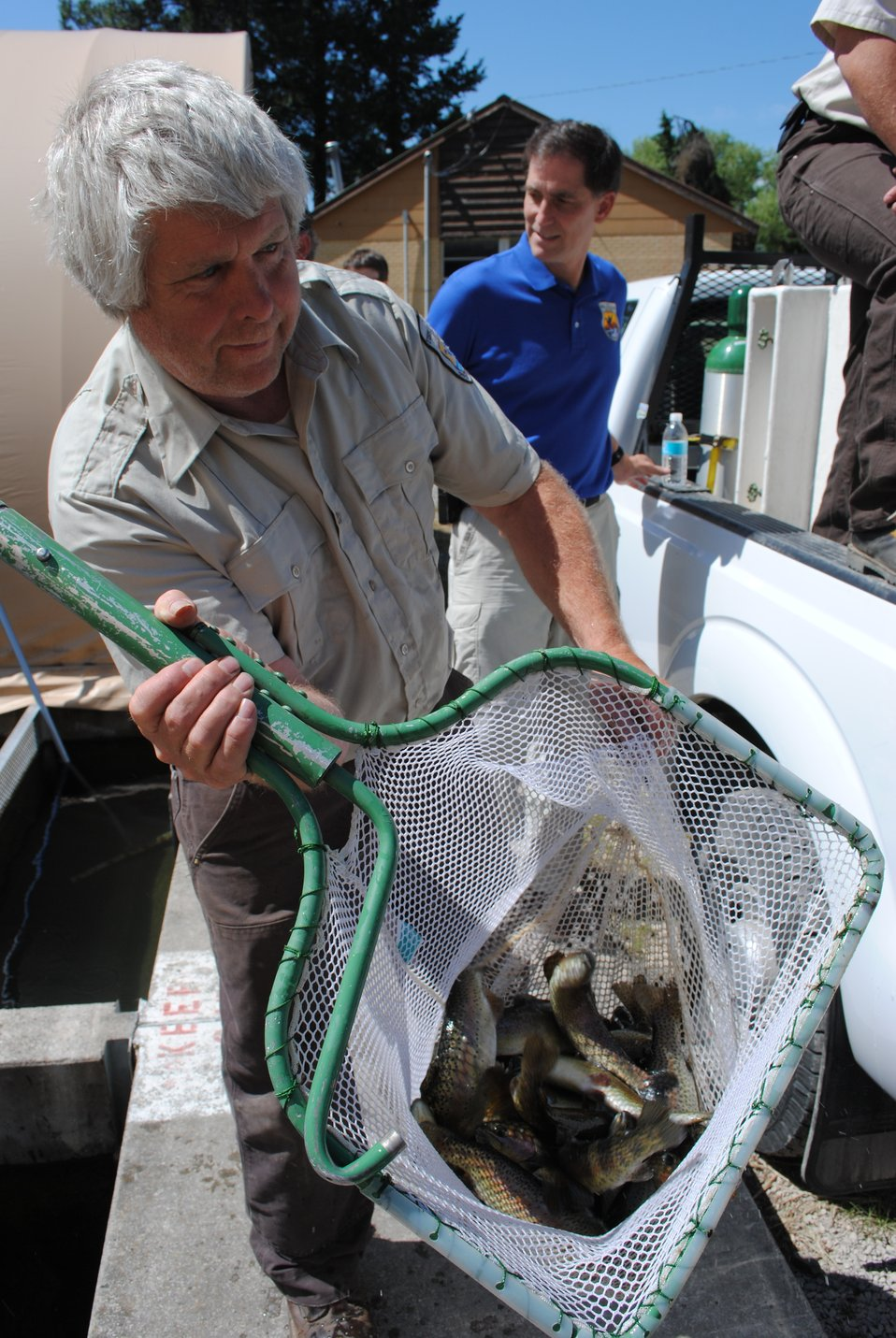 Hatchery Employee, Gar Holmes, Assists With the Fish Transfer