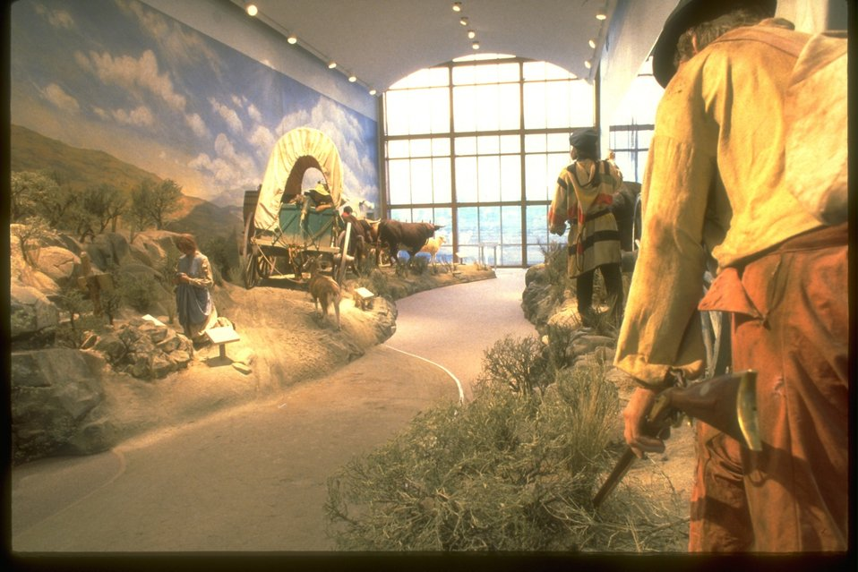 NHOTIC gallery with replicas of the Oregon Trail and early Oregon settlers.