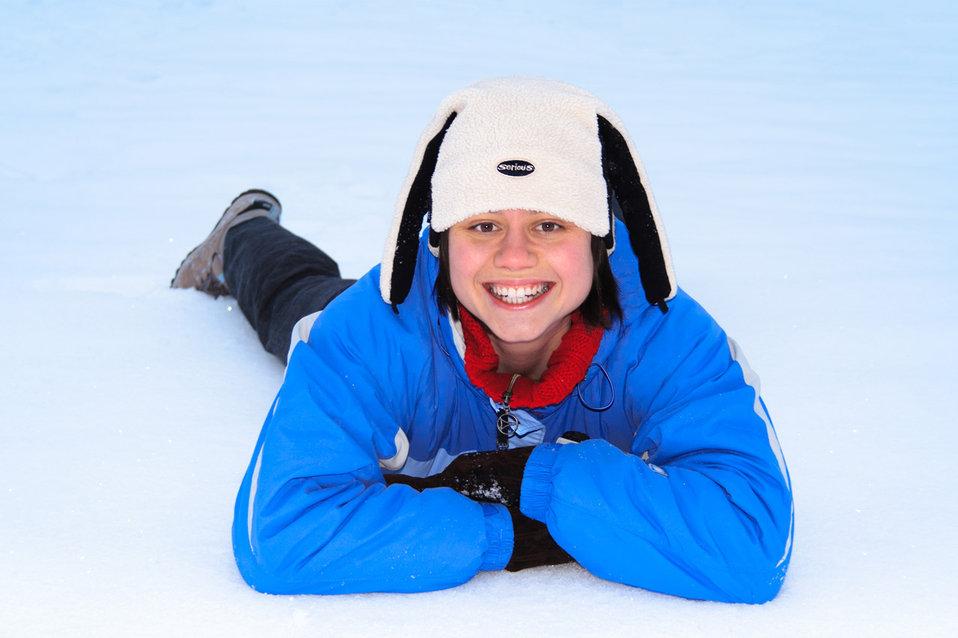 Girl lying in snow