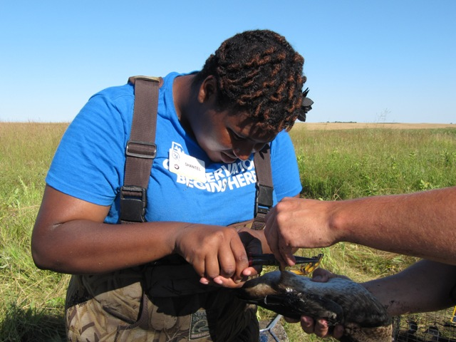 Shantel, a Career Discovery Intern, practices duck banding
