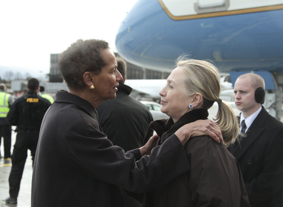Secretary Clinton Is Greeted By Ambassador King