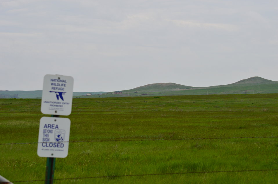 Prairie landscape with NWR sign