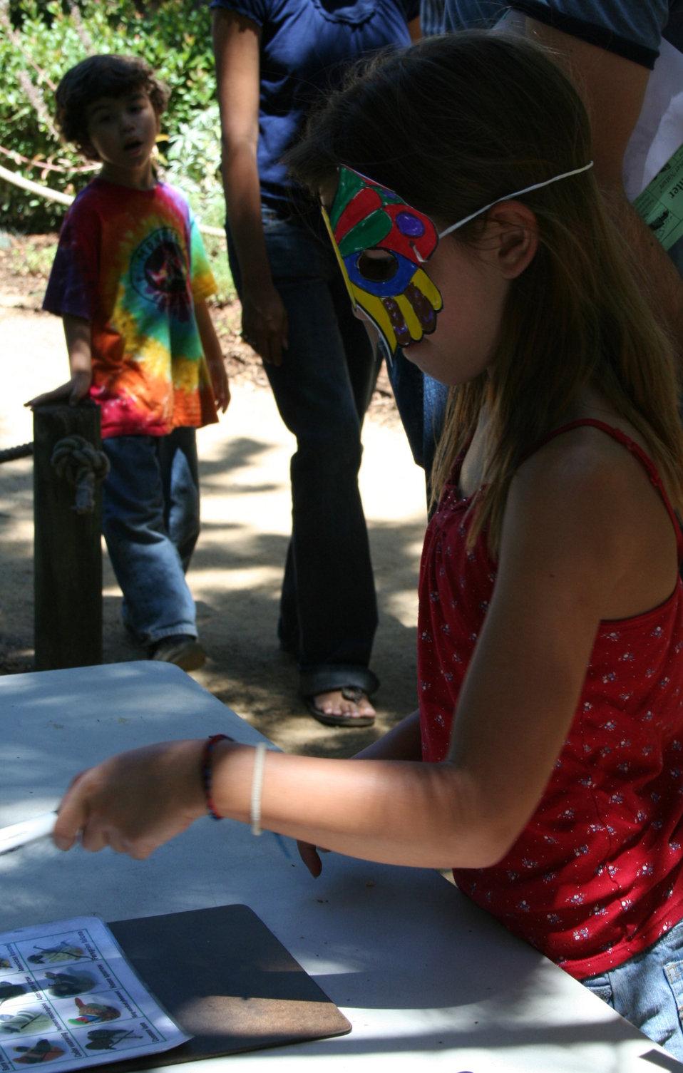Fairgoer tries her hand at bird bingo