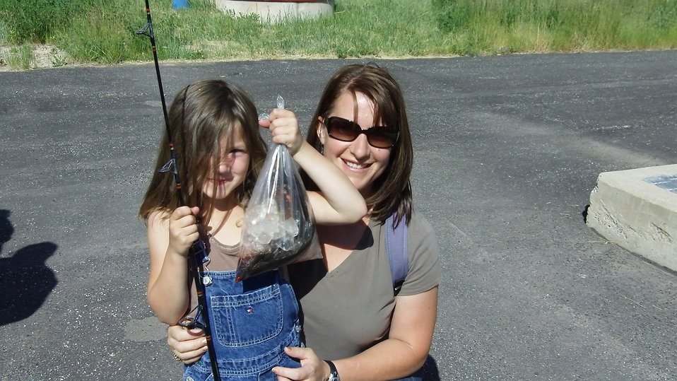 Mom and Daughter Participate in Fishing Day