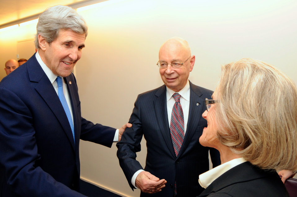Secretary Kerry is Greeted by Klaus and Hilde Schaub at 2014 World Economic Forum