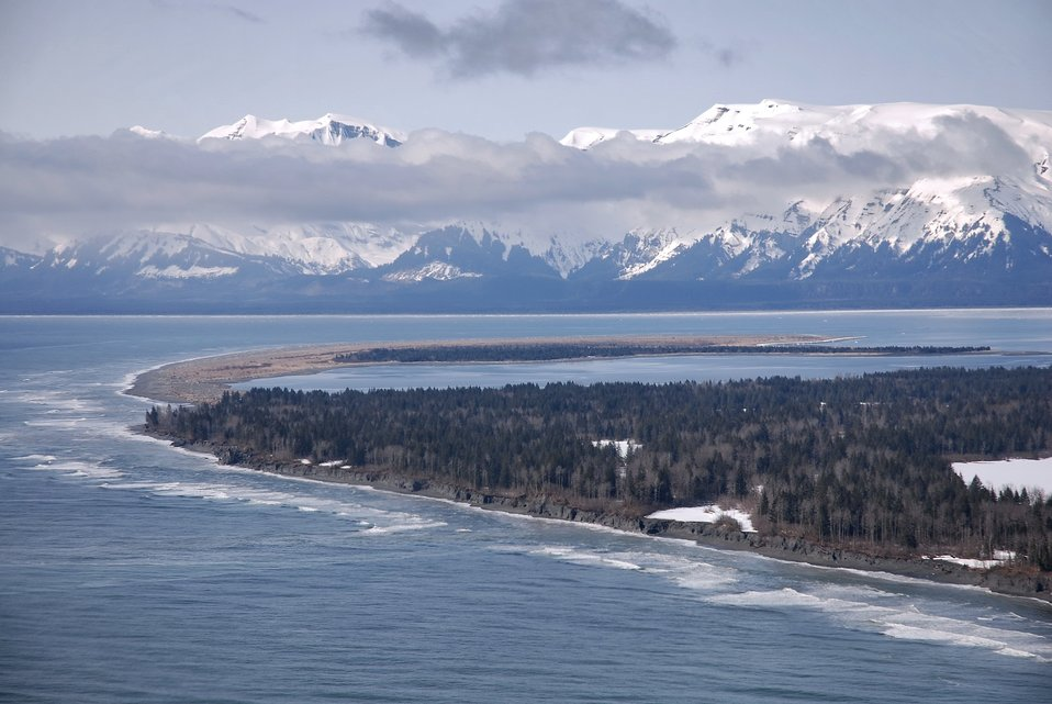 An aerial view of the south entrance to Icy Bay showing the great sandspit and the endless surf of the Gulf of Alaska.